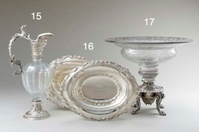 A SILVER-MOUNTED GLASS CLARET