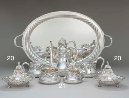 A PAIR OF SILVER SHELL BASKETS