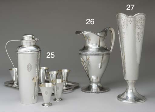A SILVER WATER PITCHER*