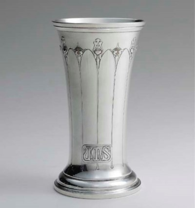 A FINE SILVER AND GOLD BEAKER