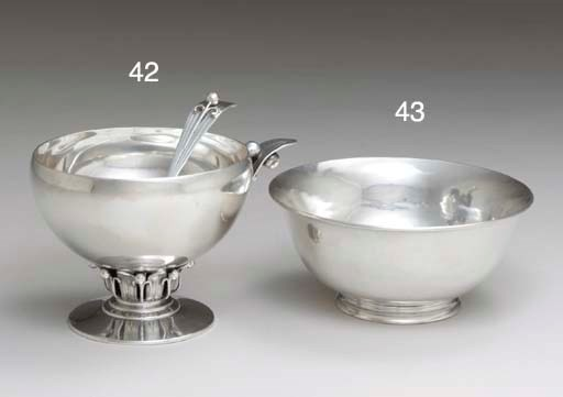 A SILVER SAUCEBOAT AND LADLE