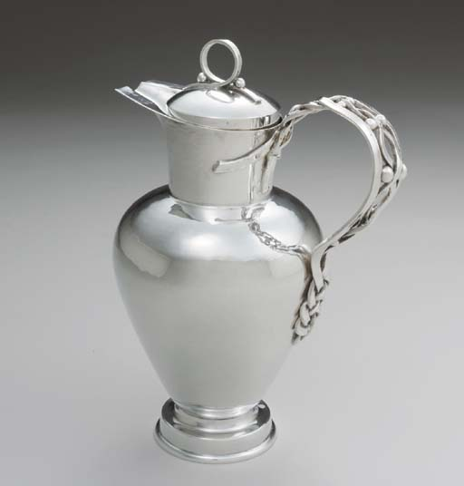 A FINE SILVER COCKTAIL PITCHER