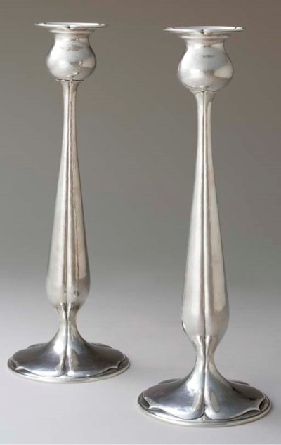 A PAIR OF LARGE SILVER CANDLES