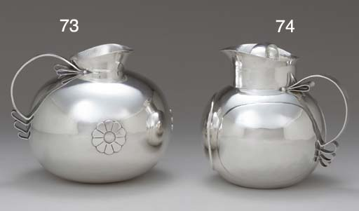 A MEXICAN SILVER WATER PITCHER