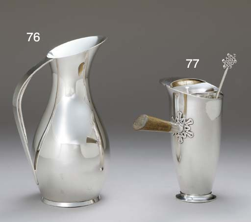 A SILVER COCKTAIL PITCHER AND