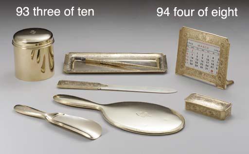 A GOLD EIGHT-PIECE DESK SET, 1