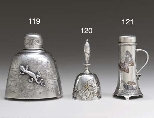 A SILVER AND MIXED-METAL BELL