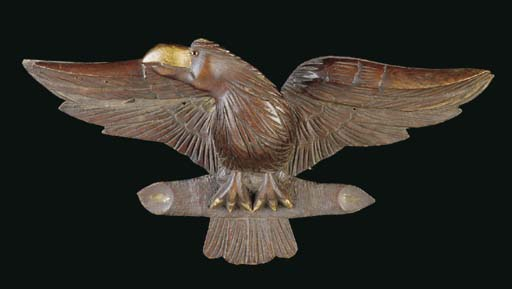 A SMALL CARVED OAK EAGLE WITH