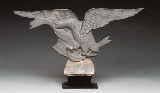 A CAST IRON SPREAD-WINGED EAGL