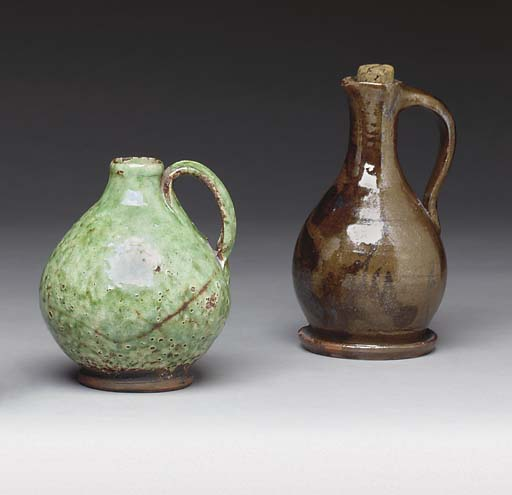 A GROUP OF TWO GLAZED REDWARE