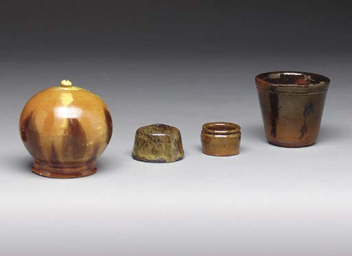 A GROUP OF FOUR GLAZED REDWARE