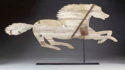 A CARVED AND PAINTED WOODEN RU