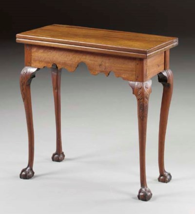 A CHIPPENDALE CARVED WALNUT CA