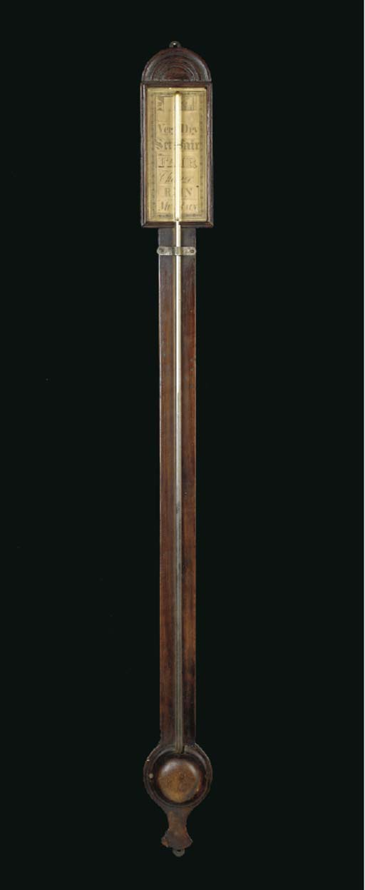 A CHIPPENDALE WALNUT STICK BAR