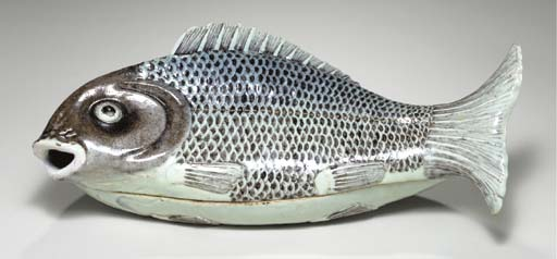 A LARGE FISH TUREEN AND COVER