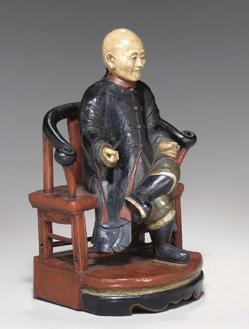 A CHINA TRADE CARVED AND PAINT