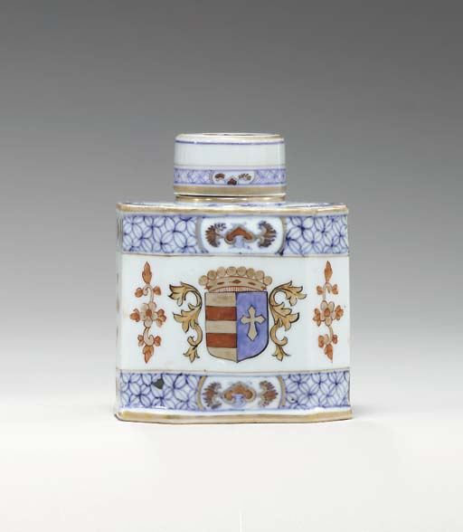 AN ARMORIAL TEA CADDY AND COVE