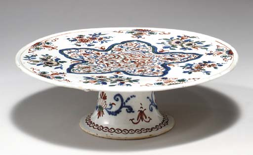 A DUTCH DELFT POLYCHROME FOOTE