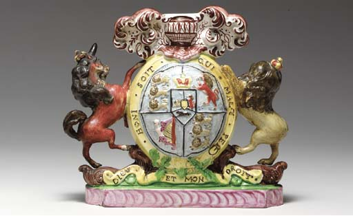 A STAFFORDSHIRE ARMORIAL SPILL