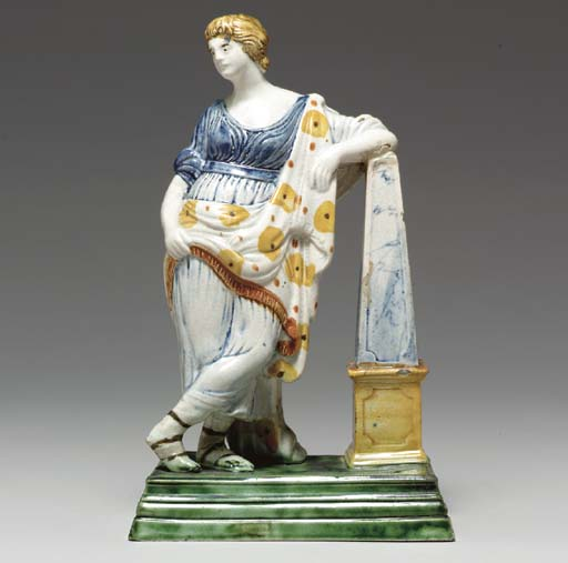 AN ENGLISH PEARLWARE FIGURE OF A MUSE