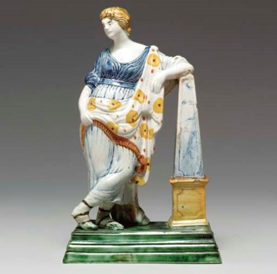 AN ENGLISH PEARLWARE FIGURE OF