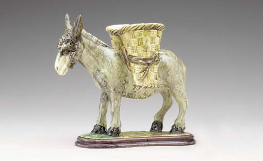 A FRENCH MAJOLICA MODEL OF A B
