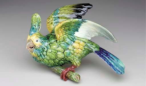 A FRENCH MAJOLICA PARROT-FORM