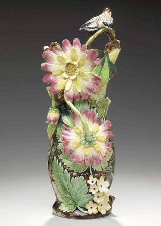 A CONTINENTAL MAJOLICA FLOWER-
