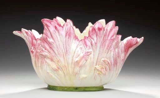 A FRENCH MAJOLICA PARROT-TULIP