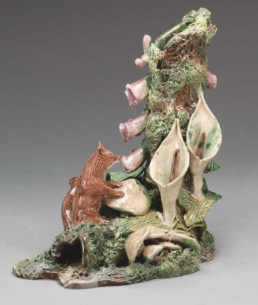 A FRENCH MAJOLICA MODEL OF A S