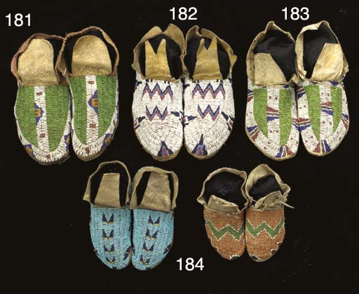 A PAIR OF PLAINS BEADED HIDE M