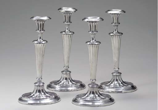 A SET OF FOUR SILVER-PLATED CA