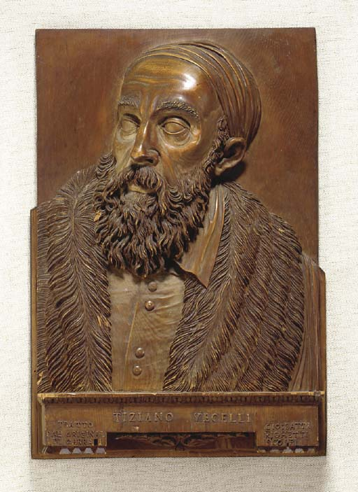 A CARVED PINE PORTRAIT RELIEF