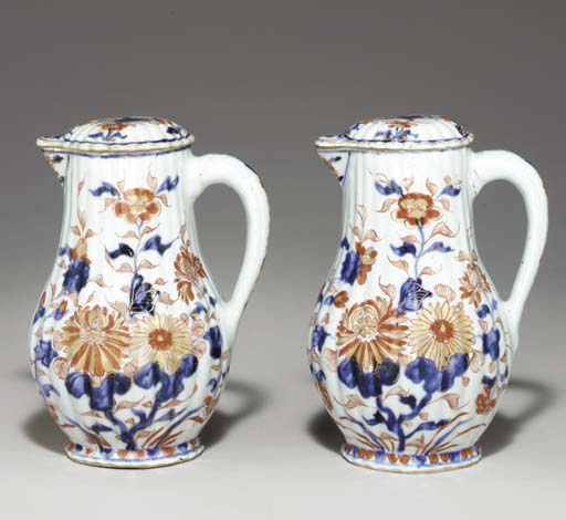 A SMALL PAIR OF JUGS AND COVER