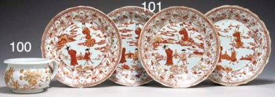 FOUR IRON-RED FLUTED DISHES