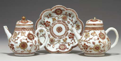 A PAIR OF TEAPOTS AND COVERS A