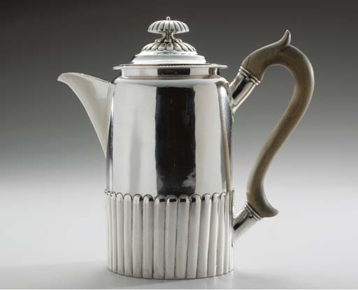 A GEORGE III SILVER COFFEE JUG