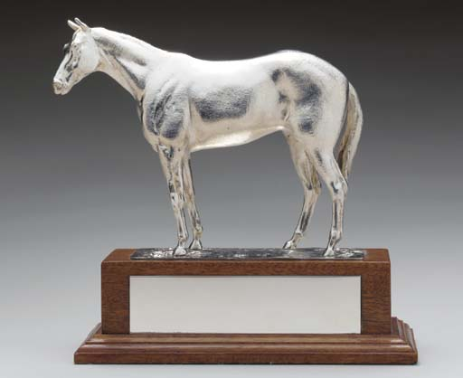 A SILVER HORSE TROPHY,