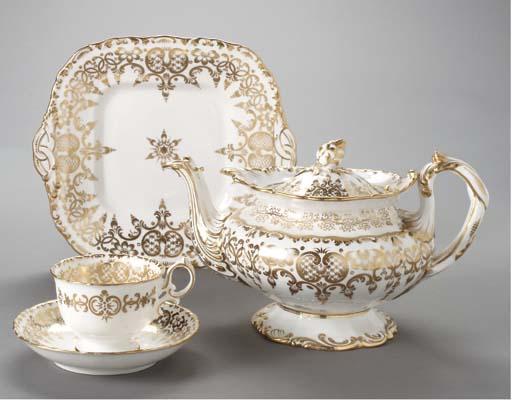 AN ENGLISH GILT WHITE PART TEA