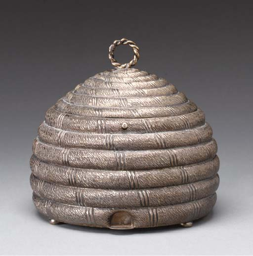 AN ENGLISH BRASS BEEHIVE FORM