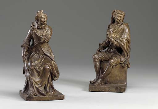A PAIR OF PAINTED PLASTER FIGU