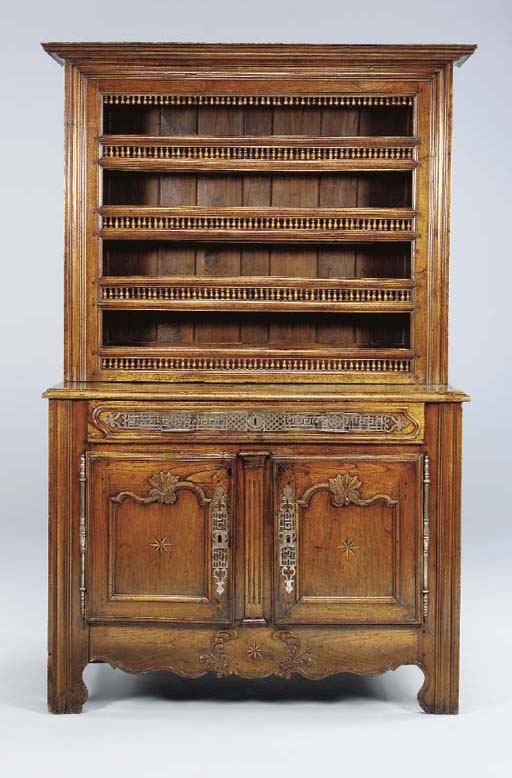 A LOUIS XV PROVINCIAL CARVED A