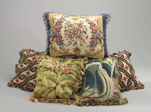 A GROUP OF FIVE PILLOWS,