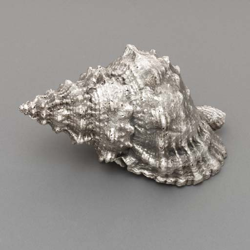 A SILVER-COATED SHELL, BY PAOL