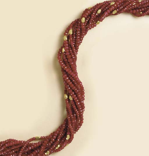 A MULTI-STRAND RUBY AND GOLD N