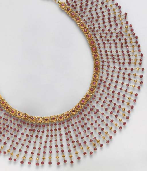 A RUBY AND 18K GOLD NECKLACE