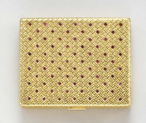 AN 18K GOLD AND RUBY CIGARETTE