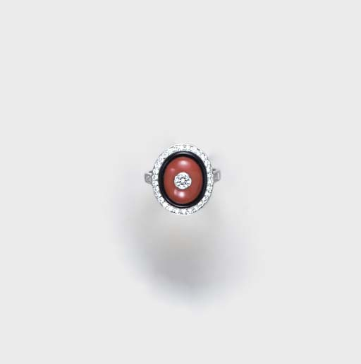 **A CORAL, ONYX, DIAMOND AND WHITE GOLD RING