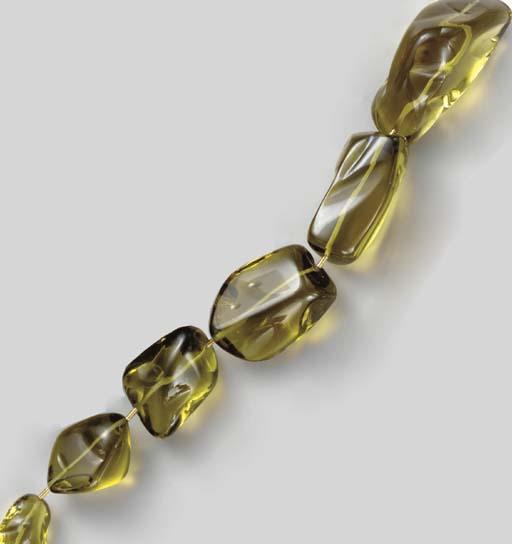 A LEMON CITRINE AND 18K GOLD N