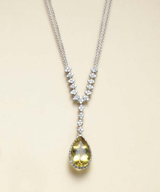 A YELLOW BERYL, DIAMOND AND 18